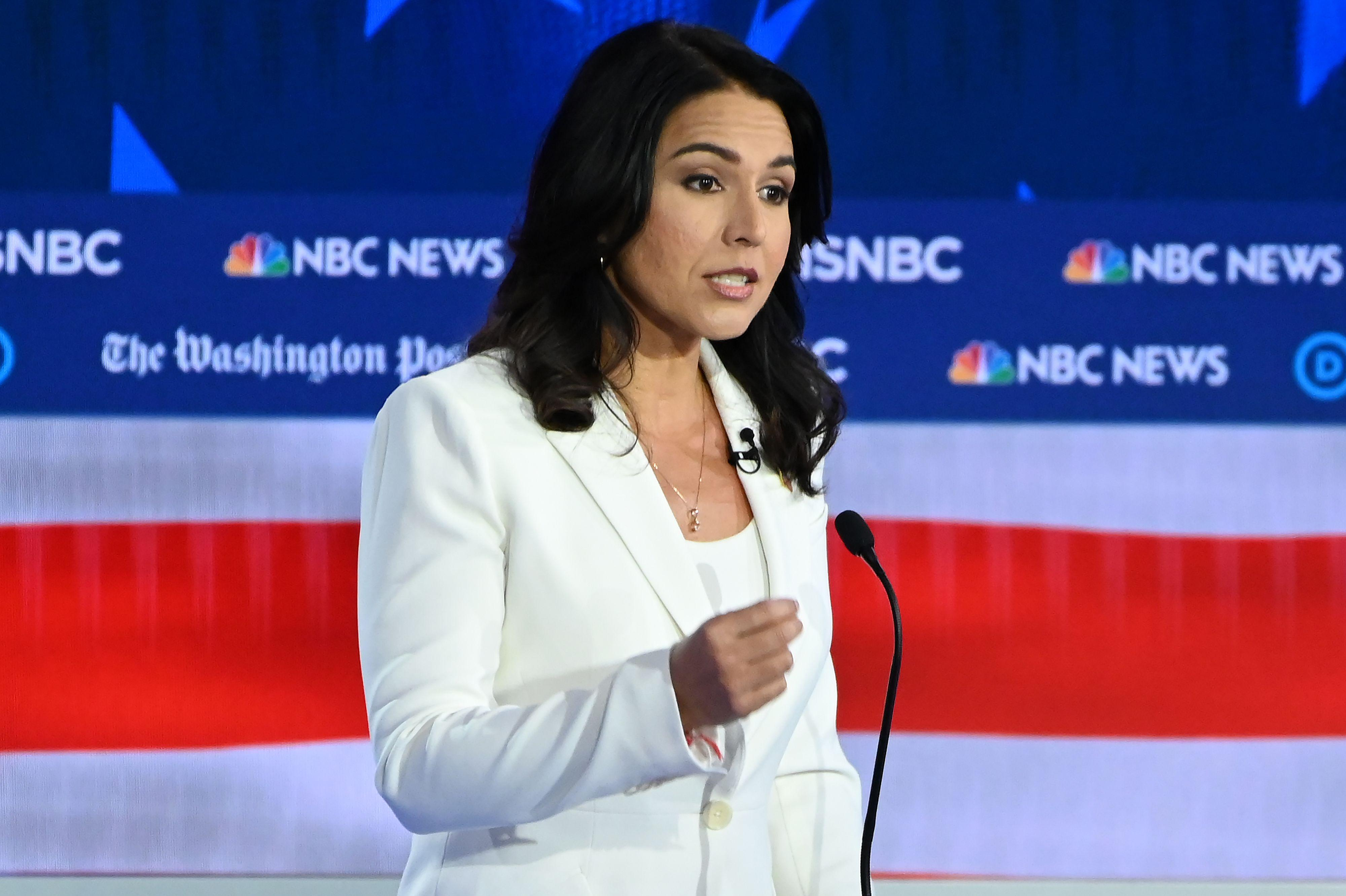 climate-change-democratic-debate-november-tulsi-gabbard-1574358826858.jpg