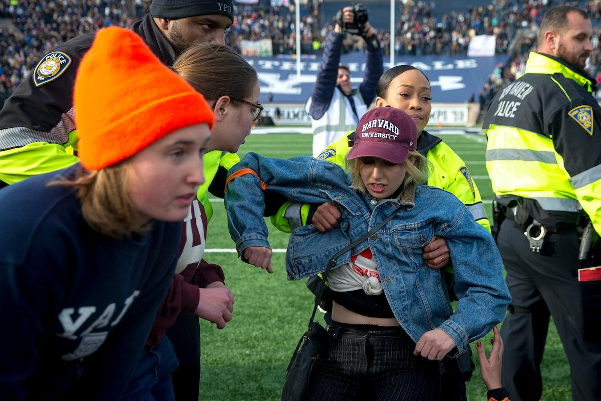 climate-protest-interrupts-harvard-yale-football-game2-1574713730400.jpg